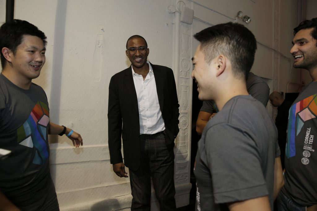 Shareef Abdur-Rahim laughs as he speaks with a team from Cornell.
